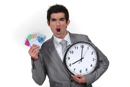 payday: Animated businessman with clock and money Stock Photo