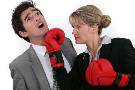 spiteful: Woman punching her colleague
