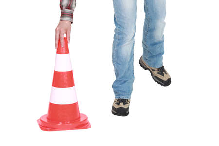 traffic cone: Setting down a traffic pylon