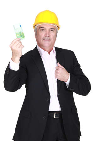 Businessman in a hardhat holding a 100 euro note photo