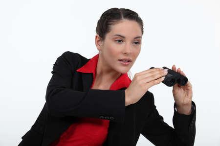 distant spot: Woman holding a set of binoculars