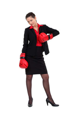 gym dress: Attractive businesswoman with her punching gloves