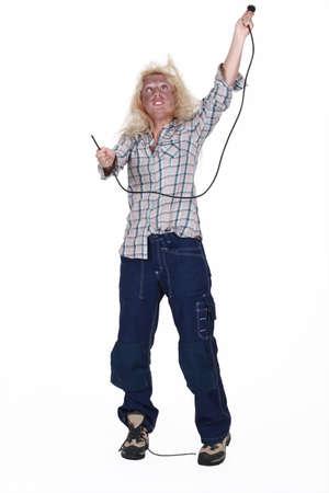 power failure: Careless female electrician Stock Photo