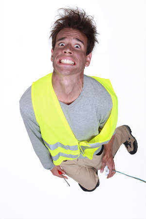 bare wire: Man being electrocuted Stock Photo