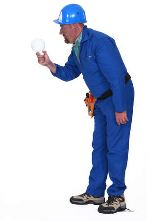 Electrocuted man staring at a light bulb Stock Photo - 15174616
