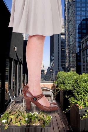 mini dress: Giant woman in urban environment Stock Photo