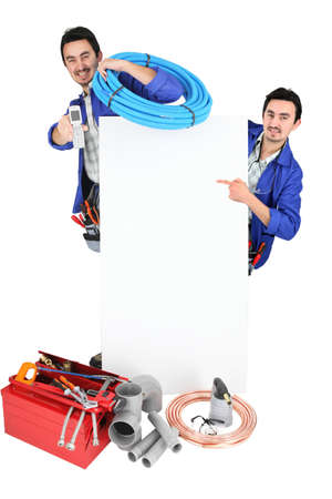 air duct: male duo of plumbers with tools Stock Photo