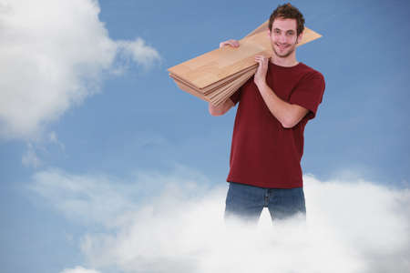 Happy carpenter standing in a cloud Stock Photo - 15175032