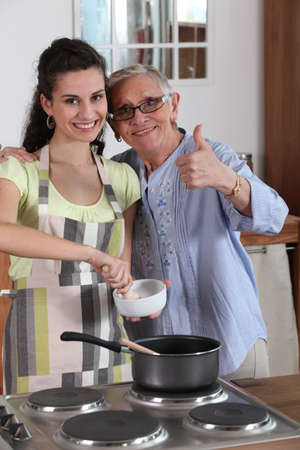 Woman cooking with her grandmother photo