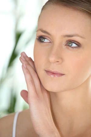 peeling: beautiful woman taking care of her skin Stock Photo