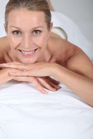 unwind: Blond woman laid on front awaiting massage