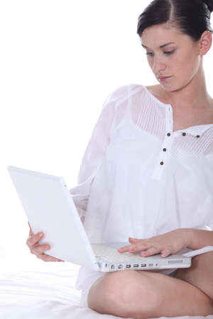 permanence: Brunette woman with computer