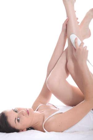 epilator: Woman using a depilation device