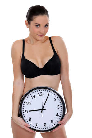 hurry up: woman in underwear holding a clock