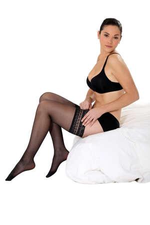 stocking feet: sexy woman putting stockings