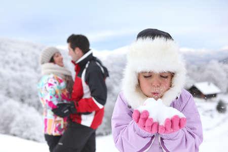 ski resort: happy couple and daughter at ski resort Stock Photo