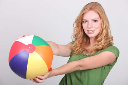 young woman with a beach ball photo
