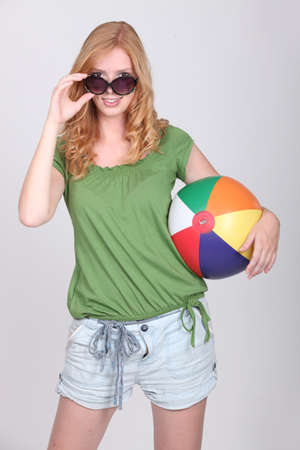 Teenage girl with inflatable beach ball photo