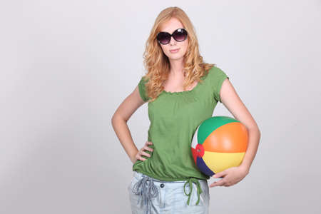 beach ball girl: Girl with inflatable beach ball wearing sunglasses