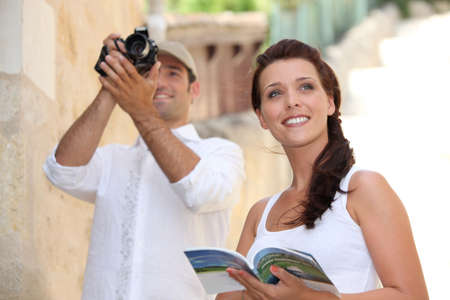 Tourists photographing monuments photo