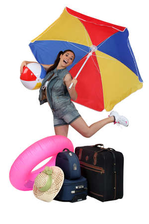 easy going: Young woman excited to go on vacation