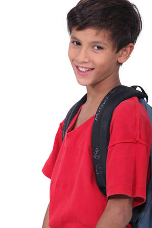 non uniform: Young schoolboy wearing a large rucksack Stock Photo