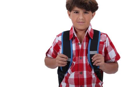 clutching: Boy ready to go to school Stock Photo