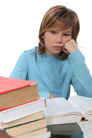 jaded: A bored child reading a book Stock Photo
