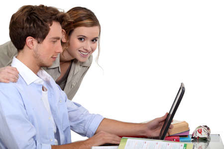 revising: Young couple revising together Stock Photo