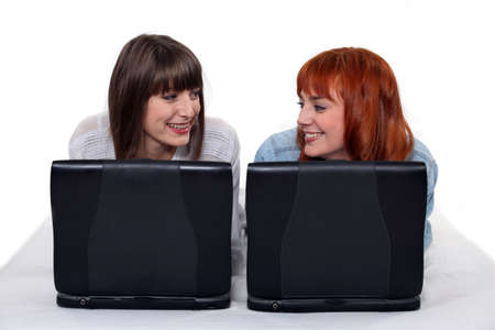 sexy young girls: Two female friends with their laptops  Stock Photo