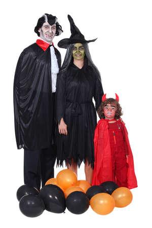 fiesta familiar: Familia en Halloween Foto de archivo