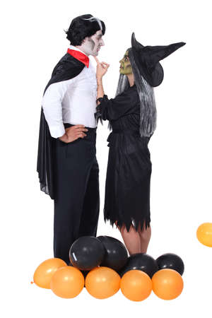 cursed: Couple at a Halloween party Stock Photo