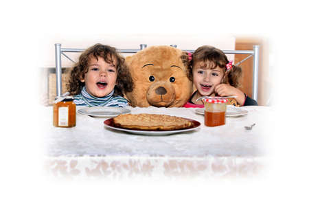 eating right: Children at a table Stock Photo