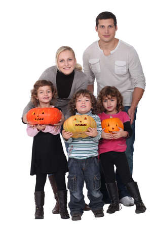 Family with Halloween jack-o photo