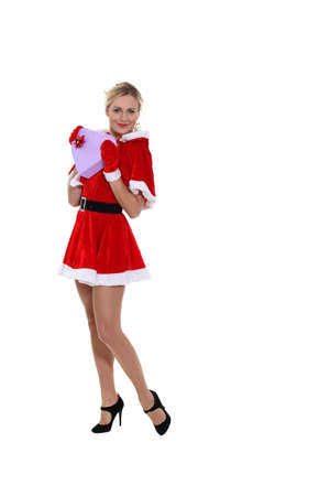 mrs  claus: Attractive woman dressed as Mrs  Claus and holding a heart-shaped box