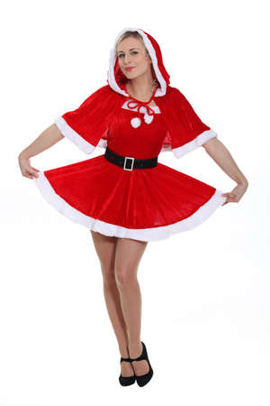 Blonde lady dressed as Miss Santa Stock Photo - 15174569