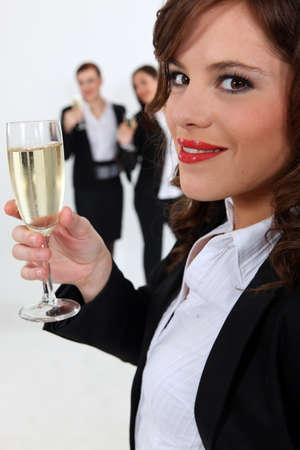 Businesswomen with champagne photo