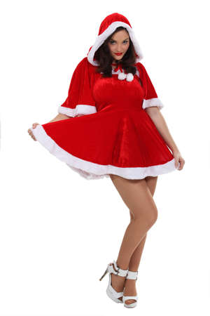 Woman dressed in a sexy Mrs  Claus costume Stock Photo