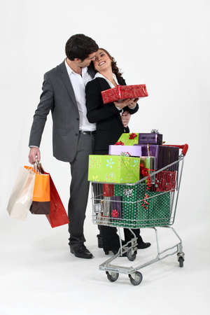 shopping trolley: young couple at shopping for Christmas