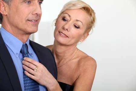 get help: Woman fixing her husband