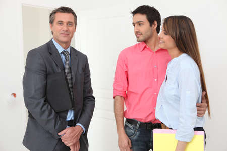inspecting: Couple meeting with a real estate realtor Stock Photo