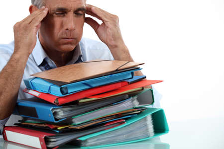 pile up: Man with stack of work Stock Photo