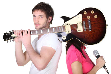 Guitarist covering his band mate photo