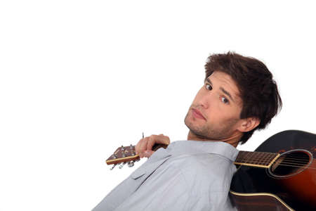 a guitarist boy playing guitar: A man with an acoustic guitar