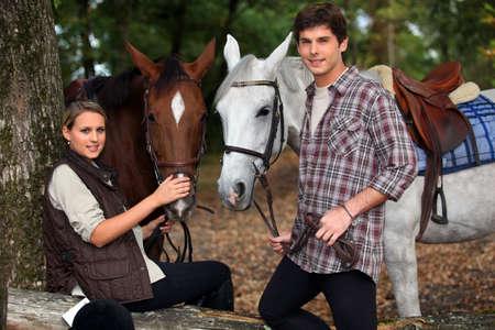horseback: young boy and girl riding horses Stock Photo