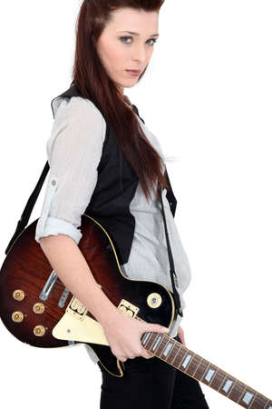 Woman with electric guitar photo