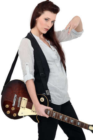 poker faced: Portrait of a female guitarist