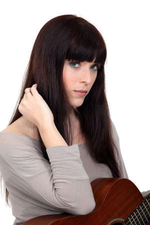 Woman beat guitar: Brunette woman with guitar