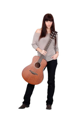 Woman posing with her guitar Stock Photo - 15225243