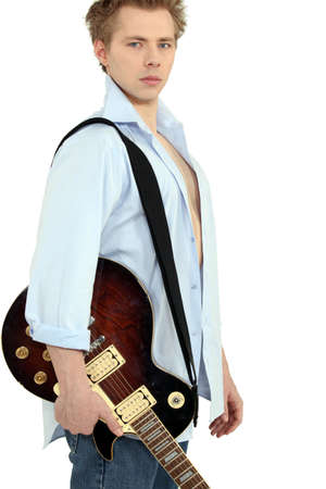 blond man with electric guitar photo